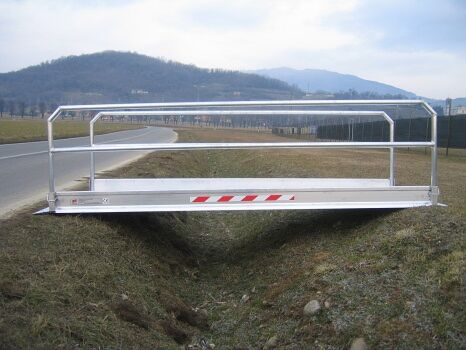 Vehicle gangway placed over trench
