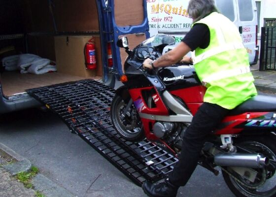 Loading motorcycle in to the back of a van