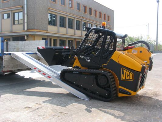 Plant machine on loading ramps