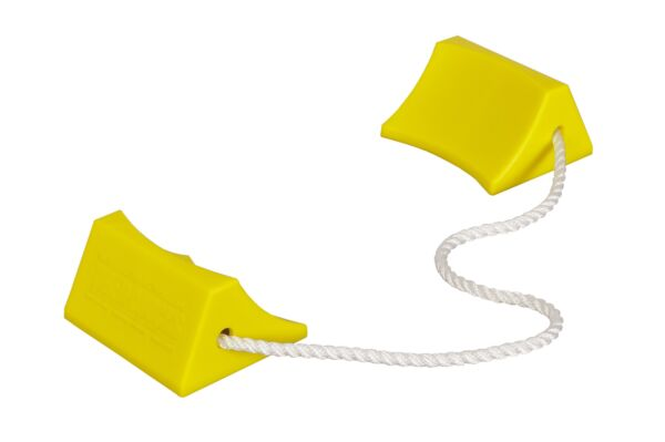 Pair of yellow aviation chocks