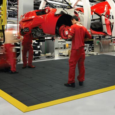 Anti-fatigue mat installed in car factory