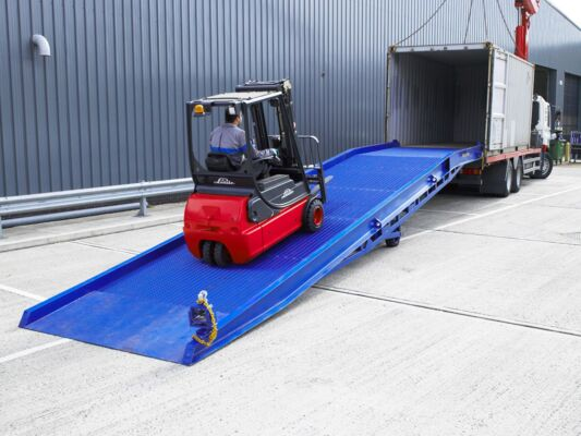 Forklift driving up yard ramp