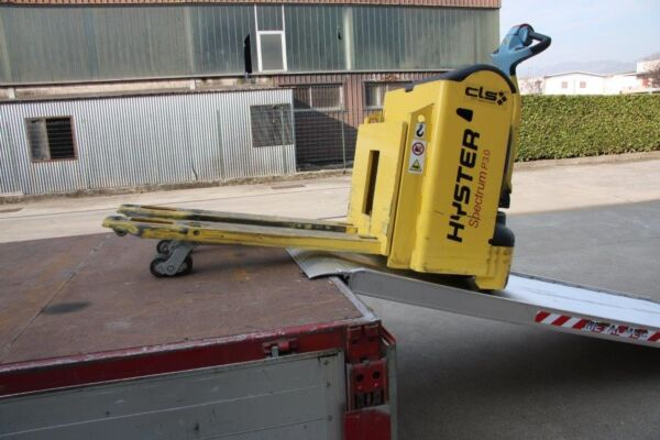Pallet truck coming off of truck ramp