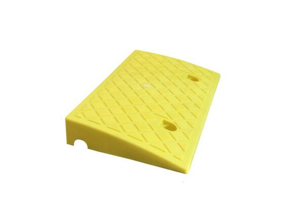 Plastic kerb ramp with a channel