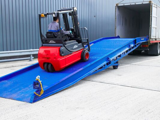Forklift driving on to yard ramp