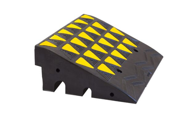 Rubber kerb ramp with channels for cables